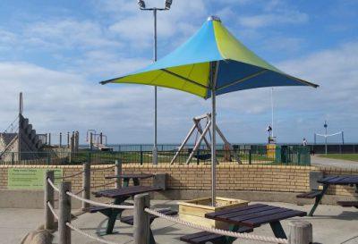 Colourful vortex parasol installation